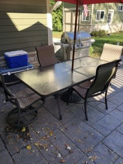 Tropitone patio dining table and chairs