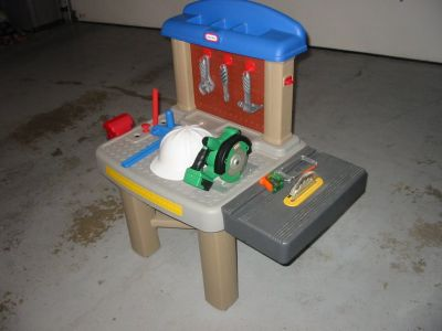 Little Tikes workbench with table saw, power saw, tools and hard hat.$18