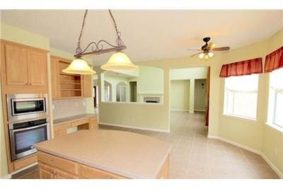 STUNNING HOME ON CUL-DE-SAC LOT FEATURING A REFRESHING CUSTOM POOL. Washer/Dryer Hookups!