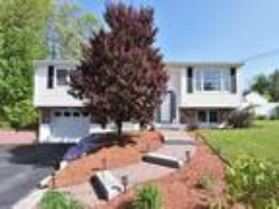 Real Estate For Sale - Four BR, 1 1/Two BA Split-level
