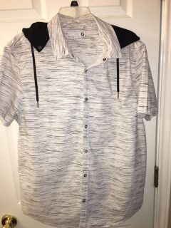 Like new Guess shirt. Size XL. Has hoodie that can be unbuttoned and taken off upon preference.