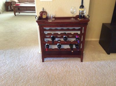 Wood wine rack with serving tray.