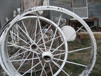 four large antique tractor wheels