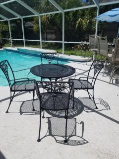 Vintage Woodard patio set from the mid-1900s.