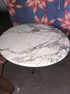 Wright Iron and Marble coffee table is looking for her forever home.