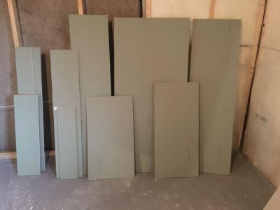 Pieces of moisture resistant drywall