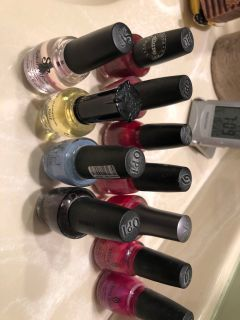 9 used nail polishes, but plenty left in each and 2 top coat