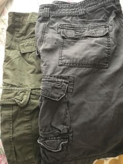 Men s 34 waist cargo shorts. Price is for both pair.