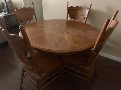 Table with 6 chairs and leaf.