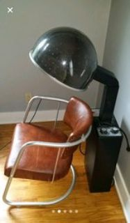overhead hairdryer and chair