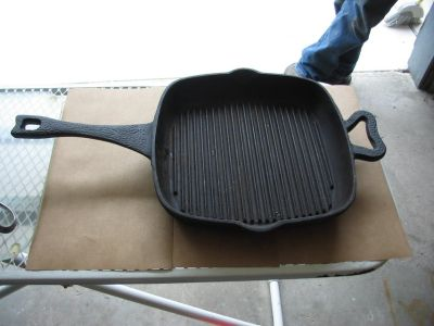 """Paula Deen 11"""" cast iron griddle with raised bars sits flat"""