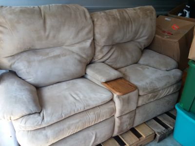 Micro- Fiber Tan/Beige color. Loveseat that reclines, Message me if interested.