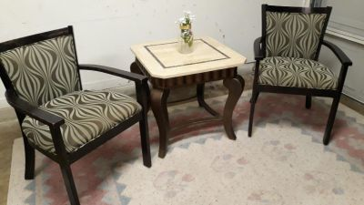 Two Chairs With An End Table