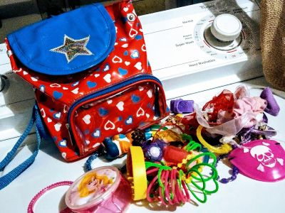 Plastic Backpack with Girly Items