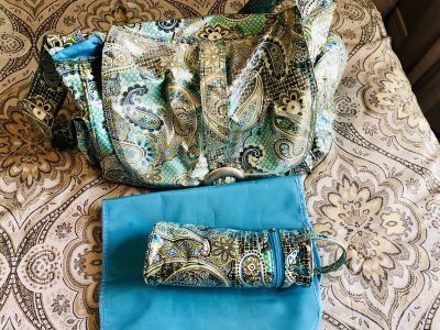 Diaper bag with changing pad and bottle warmer