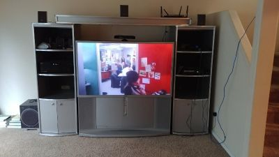 "55"" Sony TV, Sony Stereo with speakers, and entertainment center."