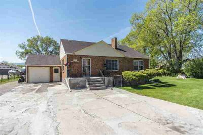 1323 Kinghorn Pocatello Four BR, Classic brick home rests on .85