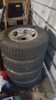 4 brand new winterforce snow tires on 5 bolt ford rims size 245/70/16