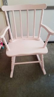 Adorable pink wood rocking chair!