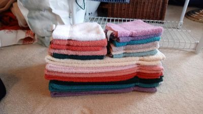 Various color (7) hand towels & (11) washcloths.
