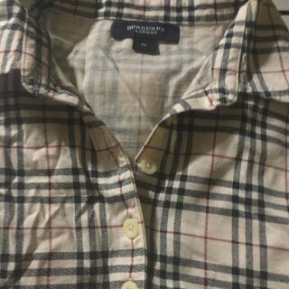 Pre owned Girls Burberry shirt size medium great condition no wear or tear