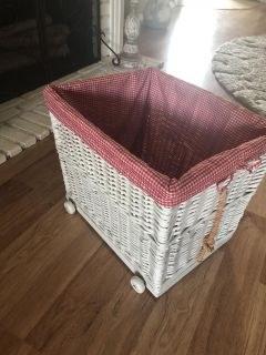 Pottery barn basket. 17 long 14 wide 15 tall. Has wheels and a rope for pulling .