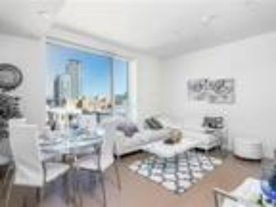 Downtown condo with spectacular skyline views with luxury amenities.