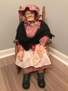 Porcelain Grandma in rocking chair with apples