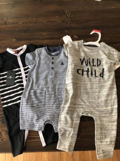 An assortment of new with tags boys outfits 3-6 months.