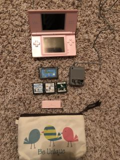 Pink Nintendo DS with games (no stylus pen)