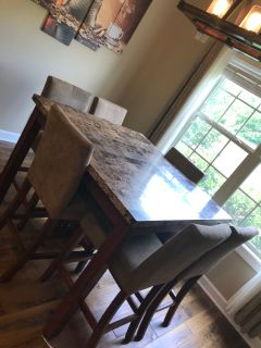 Bar height granite top kitchen table with 6 chairs