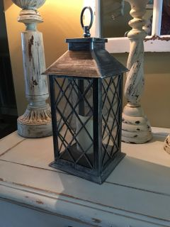CUTE LANTERN measures 14 inches tall with a battery operated candles that works (see other pic) it s 14 inches
