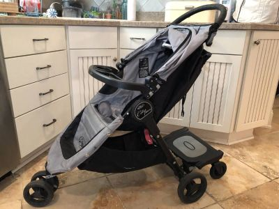Baby Jogger City Micro Stroller plus Child Tray and Glider Board for $100: