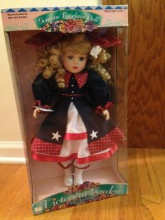 Porcelain Doll/New in box