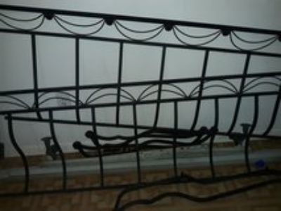 wrought iron sleigh bed California king size