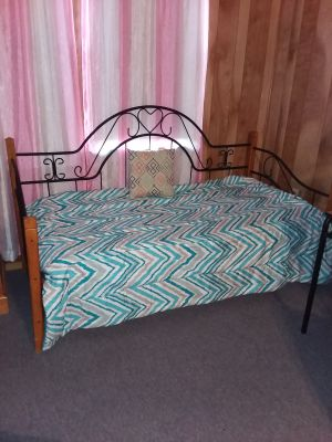 Wood and metal day bed with twin mattress like new excellent condition!! Must pick up. Twin bedding comforter and sheet set included if want