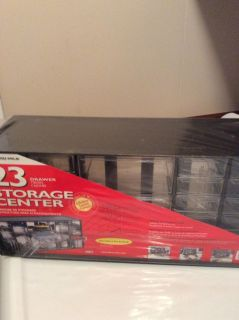 NEW 23 DRAWER AKRO - MIL STORAGE CENTER. ( STILL WRAPPED IN PAPER)