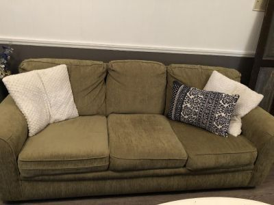 Olive green couch.good condition. Non-smoking home