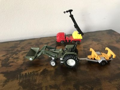 Army Green Tractor with front loader that can go up and down, plus the front box can move up and down. Attachment trailer. Red Vehicle with