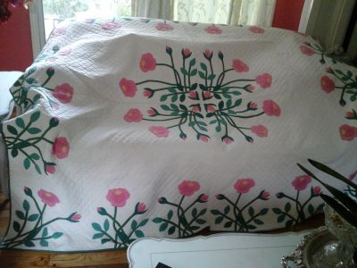 Vintage pink and green roses quilt