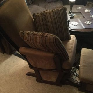 Tan Cushion Arm Rocking Chair with Pillows and Gold Throw Blanket