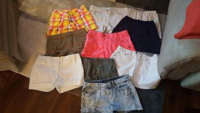 7 Women size 2-4 shorts and 3 skirts small with stretch waist
