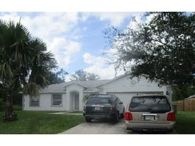 4 Bed 2 Bath Foreclosure Property in Port Saint Lucie, FL 34953 - SW Spataro Ave