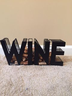Home decor. Metal wine decor that comes with approx 20 corks. Porch pick up near White House middle school
