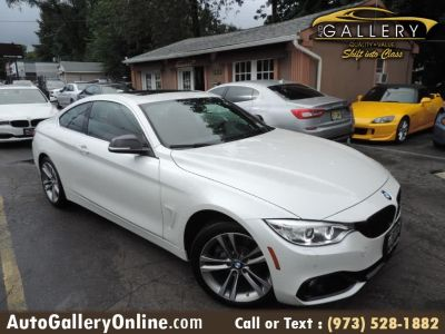 2016 BMW 4 Series 2dr Cpe 428i xDrive AWD SULEV (Alpine White)