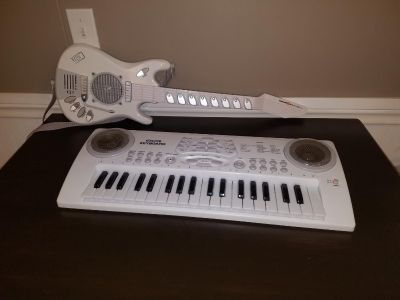 Battery operated keyboard and guitar