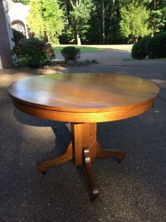 Antique solid oak round table with leaf