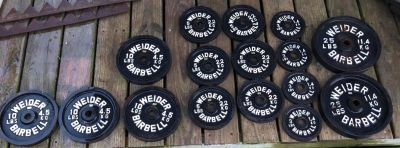 1970 s is Vintage Weider Barbell Weights & Weight Holder there is 132 lbs in all.