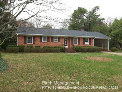 Charming home with wood floors, a 1 car carport, large fenced in back yard, and a nice deck.