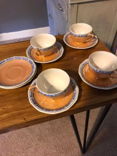 Four cups and saucers with two extra saucers